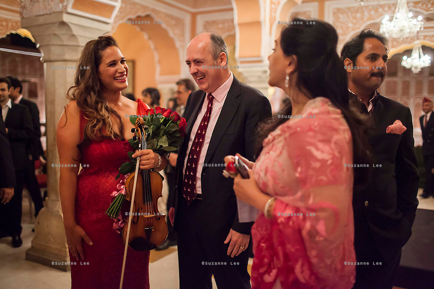(L-R) Australian violinist Niki Vasilakis, Australia's High Commissioner to India, Dr. Lachlan Strahan, and Princess Diya Kumari of the Royal Family of Jaipur share a light conversation after her solo violin concert played to a prominent audience, including the Jaipur Royal Family, and other VIPs at the OzFest Gala Dinner in the Jaipur City Palace, in Rajasthan, India on 10 January 2013. Photo by Suzanne Lee