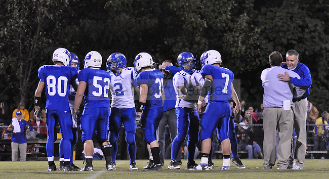 Head Coach Mike Holcomb and seniors walk to the coin toss during Breathitt County's game against the Morgan County Cougars on Friday, Oct. 14, 2011, in Jackson, Ky. Several of the coaches on Morgan County's team used to play for Holcomb at Breathitt.    Photo by Taylor Moak