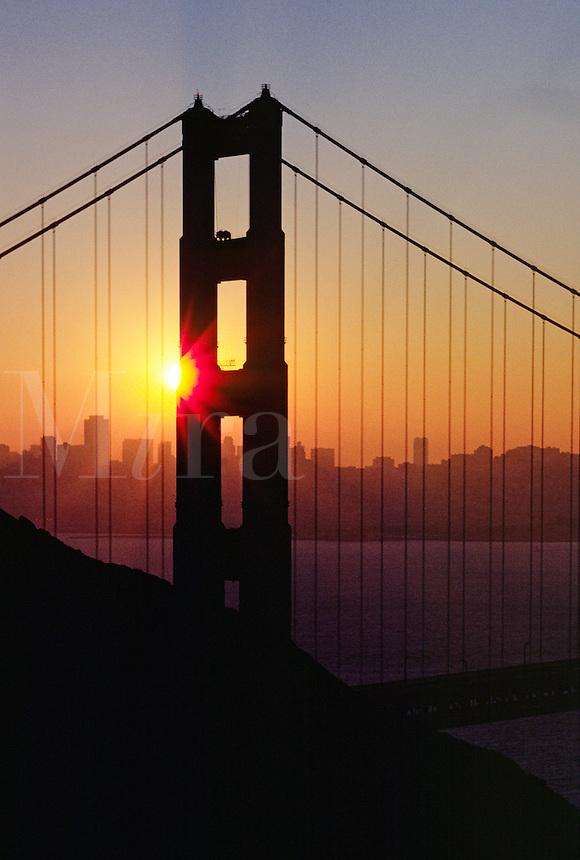 Silhouette of GOLDEN GATE BRIDGE in STARBURST SUNSET - SAN FRANCISCO, CALIFORNIA, USA
