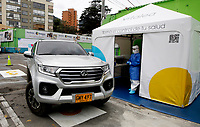 BOGOTA, COLOMBIA - MAY 13: A car arrives to a COVID-19 drive-through test point on May 13, 2020 in Bogota. The drive-through test point, the first in Colombia, had a capacity to take 1,400 Covid-19 test a month with a cost of $50 dollars to every patient. (Photo by Leonardo Munoz/VIEWpress via Getty Images)