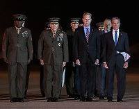 Members of the Official Party, including Governor John Carney (Democrat of Delaware), Sergeant Major of the United States Marine Corps Ronald Green, US Marine Corps General Robert B. Neller, Commandant of the Marine Corps, acting US Secretary of Defense Patrick M. Shanahan, and US Senator Tom Carper (Democrat of Delaware), pay their respects during the Dignified Transfer of the remains of United States Marine Corps Staff Sergeant Christopher A. Slutman at Dover Air Force Base in Dover, Delaware on April 11, 2019.  Members of the Official Party, including Governor John Carney (Democrat of Delaware), Sergeant Major of the United States Marine Corps Ronald Green, US Marine Corps General Robert B. Neller, Commandant of the Marine Corps, acting US Secretary of Defense Patrick M. Shanahan, and US Air Force Colonel Matthew Jones, 436th Airlift Wing, Vice Commander, pay their respects during the Dignified Transfer of the transfer case containing the remains of United States Marine Corps Staff Sergeant Christopher A. Slutman at Dover Air Force Base in Dover, Delaware on April 11, 2019. He died as the result of a road-side bomb in Afghanistan on April 8, 2019.  Staff Sergeant Slutman, a decorated 15 year veteran of the Fire Department of New York (FDNY), was married and had three children. Photo Credit: Ron Sachs/CNP/AdMedia