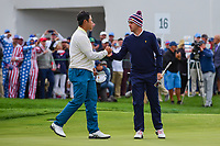 Hideki Matsuyama (JPN) shakes hands with Justin Thomas (USA) following their match during round 3 Four-Ball of the 2017 President's Cup, Liberty National Golf Club, Jersey City, New Jersey, USA. 9/30/2017.<br /> Picture: Golffile | Ken Murray<br /> <br /> All photo usage must carry mandatory copyright credit (&copy; Golffile | Ken Murray)