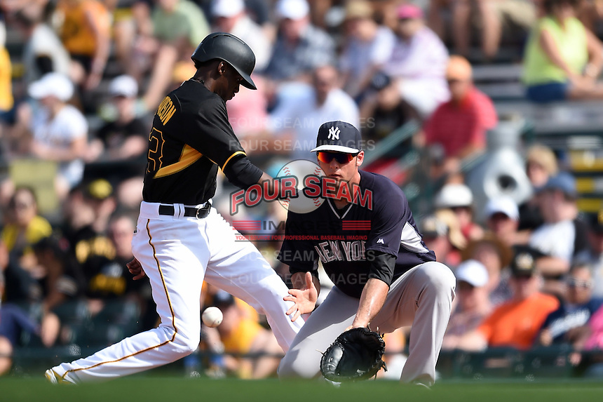 New York Yankees first baseman Greg Bird (95) waits for a throw as Alen Hanson (63) gets back to the bag during a Spring Training game against the Pittsburgh Pirates on March 5, 2015 at McKechnie Field in Bradenton, Florida.  New York defeated Pittsburgh 2-1.  (Mike Janes/Four Seam Images)