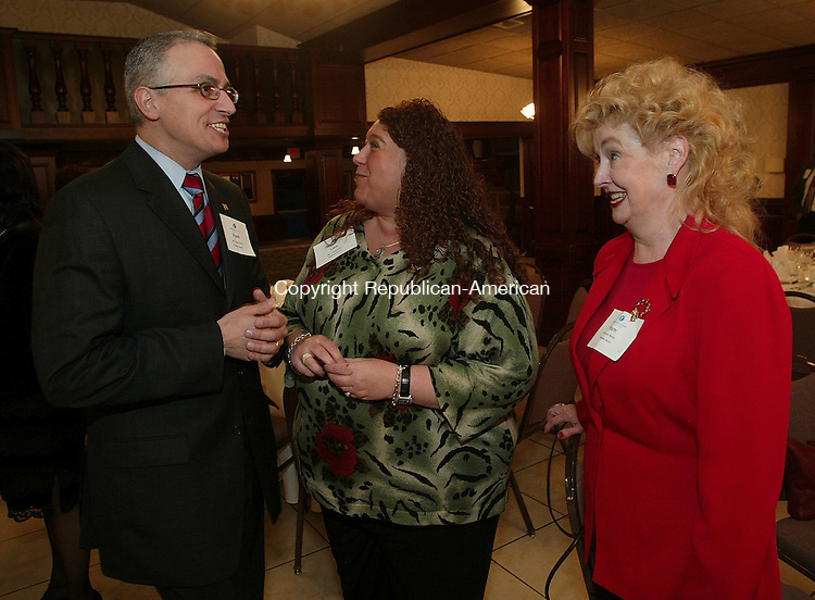 SOUTHINGTON, CT - 01 March 2005 -030105BZ12-  From left- Frank Tavera, Executive Director of the Palace Theater; Lisa Martin, V.P. at Webster Bank; and Pam White, sales for Webster Investments<br /> <br />  during the State of the State Legislative dinner at the Aqua Turf in Southington Tuesday night.  <br /> Jamison C. Bazinet Photo