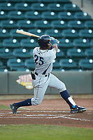 Seuly Matias (25) of the Wilmington Blue Rocks follows through on his swing against the Winston-Salem Dash at BB&T Ballpark on April 16, 2019 in Winston-Salem, North Carolina. The Blue Rocks defeated the Dash 4-3. (Brian Westerholt/Four Seam Images)