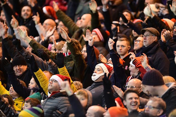 Lincoln City fans celebrate their teams goal<br /> <br /> Photographer Chris Vaughan/CameraSport<br /> <br /> The EFL Sky Bet League Two - Lincoln City v Stevenage - Tuesday 26th December 2017 - Sincil Bank - Lincoln<br /> <br /> World Copyright &copy; 2017 CameraSport. All rights reserved. 43 Linden Ave. Countesthorpe. Leicester. England. LE8 5PG - Tel: +44 (0) 116 277 4147 - admin@camerasport.com - www.camerasport.com