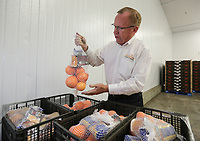 Feb. 20, 2019. San Diego, CA. USA| Feeding San Diego's CEO Vince Hall  in the refrigerator with oranges. | Photos by Jamie Scott Lytle. Copyright.