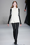 Donna Loos walks the runway in a Nicole Miller Fall 2011 outfit, during Mercedes-Benz Fashion Week.