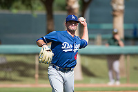 Los Angeles Dodgers relief pitcher Bryan Warzek (40) throws to first base during an Instructional League game against the Oakland Athletics at Camelback Ranch on October 4, 2018 in Glendale, Arizona. (Zachary Lucy/Four Seam Images)