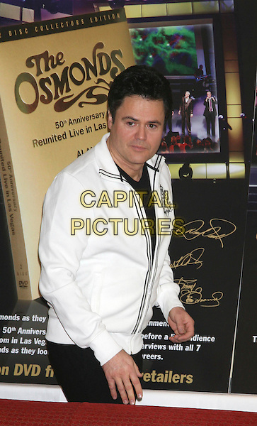 "DONNY OSMOND.The Osmonds attend a photocall to celebrate their No 1 selling DVD ""The Osmonds 50th Anniversary Reunion Concert"", .London, England, UK, 29th May 2008..half length white jacket .CAP/DS.©Dudley Smith/Capital Pictures"