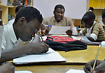 A refugee boy takes notes in class in a school operated by St. Andrew's Refugee Services in Cairo, Egypt. Located at St. Andrews United Church of Cairo, the program is supported by Church World Service.