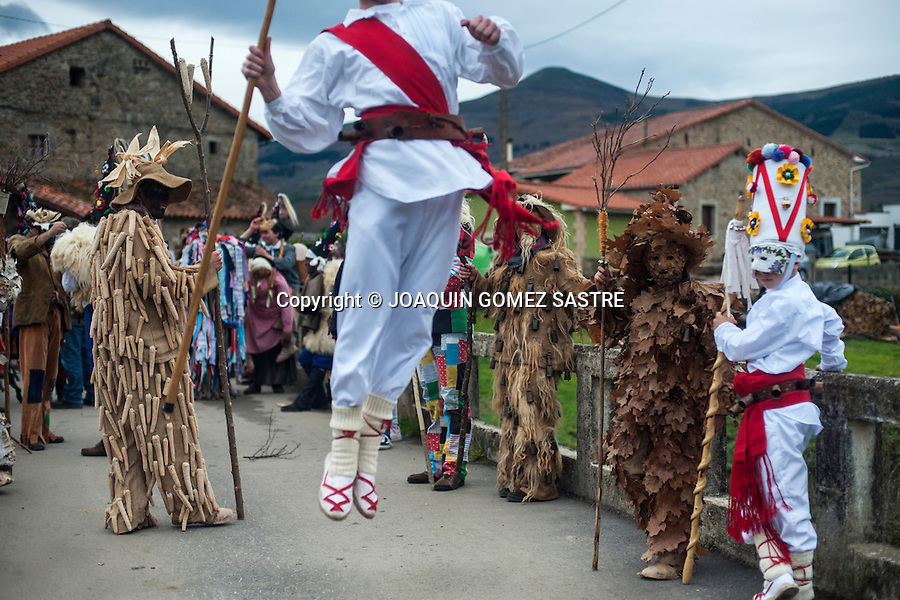 A white Danzarin (another character carnival Vijanera) leaping during the tour of the village of Silio (Cantabria)