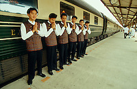 """Stewards of the Eastern & Oriental Express welcoming passengers with a traditional """"Wai""""."""