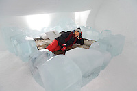Sweden, SWE, Kiruna, 2006-Apr-12: A tourist lying on a bed in a bedroom of the Jukkasjarvi icehotel.