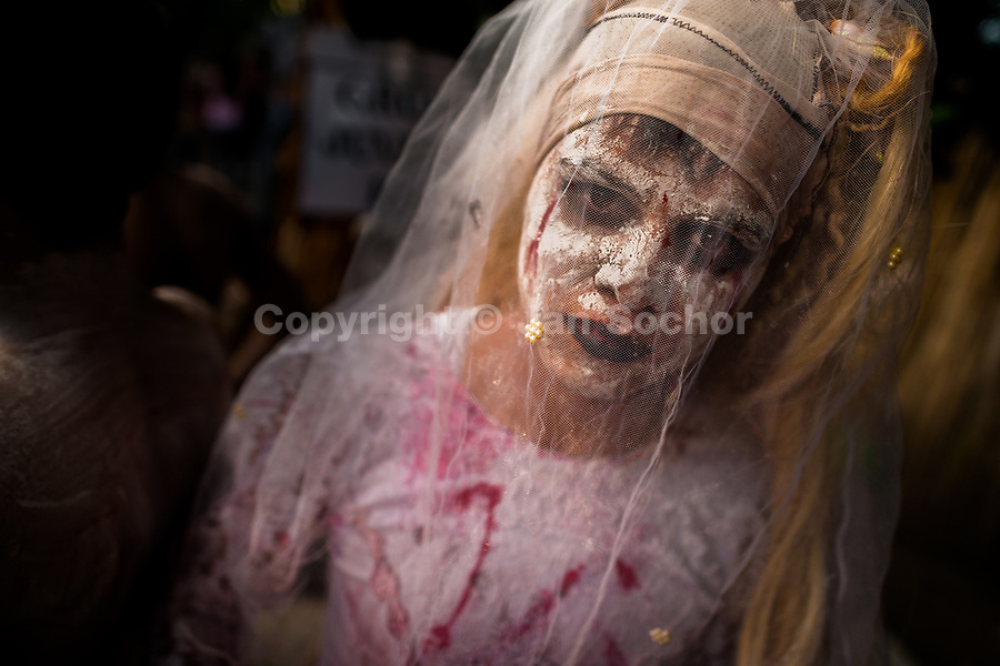 A Salvadoran young man, with white face paint, performs an indigenous mythology character called La Llorona in the La Calabiuza parade at the Day of the Dead festivity in Tonacatepeque, El Salvador, 1 November 2016. The festival, known as La Calabiuza since the 90s of the last century, joins Salvador's pre-Hispanic heritage and the mythological figures (La Sihuanaba, El Cipitío, La Llorona etc.) collected from the whole Central American region, together with the catholic All Saints Day holiday and its tradition of honoring the dead relatives. Children and youths only, dressed up in scary costumes and carrying painted carts, march from the local cemetery to the downtown plaza where the party culminates with music, dance, drinking and eating pumpkin (Ayote) with honey.