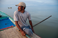 An Indonesian fisherman on his boat nearing sunset.