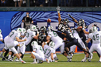 20 December 2011:  FIU's special teams unit (pictured, defensive end Tourek Williams (97), defensive back Richard Leonard (3)) attempt to block a field goal attempt by Marshall kicker Tyler Warner (37) in the first quarter as the Marshall University Thundering Herd defeated the FIU Golden Panthers, 20-10, to win the Beef 'O'Brady's St. Petersburg Bowl at Tropicana Field in St. Petersburg, Florida.