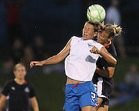 Lori Lindsey #6  of the Washington Freedom goes for a header with Maggie Tomecks #5 of the Boston Breakers during a WPS match at the Maryland Soccerplex, in Boyd's, Maryland, on April 18 2009.