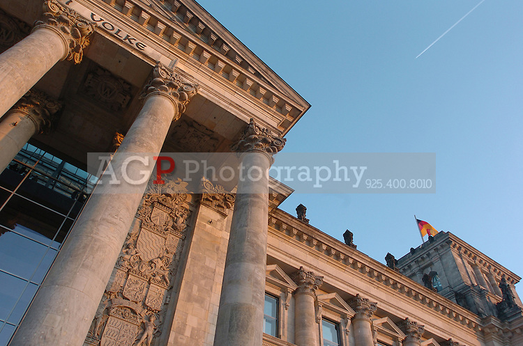 The Reichstag building in Berlin photographed December 28, 2008. It was opened in 1894 and housed the Reichstag until 1933, when it was severely damaged in a fire supposedly set by Dutch communist Marinus van der Lubbe, who was later beheaded for the crime. The building remained in ruins until the reunification of Germany, when it underwent reconstruction led by internationally renowned architect Norman Foster. After its completion in 1999, it became the meeting place of the modern German parliament, the Bundestag. (Photo by Alan Greth)