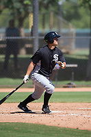 Justin Yurchak (65) of the Chicago White Sox follows through on his swing during an Instructional League game against the Los Angeles Dodgers on September 30, 2017 at Camelback Ranch in Glendale, Arizona. (Zachary Lucy/Four Seam Images)
