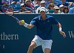 John Isner (USA), defeats Novak Djokovic (SRB) 7-6, 3-6, 7-5, at the Western & Southern Open in Mason, OH on August 16, 2013.