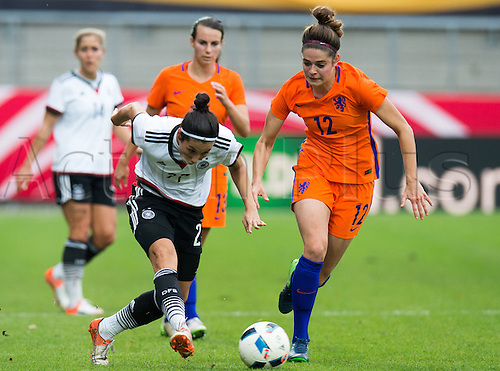 25.10.2016. Aaeln, Germany.  Germany's Sara Doorsoun (L) and the Netherland's Tessel Middag challenge for the ball during the women's international soccer match between Germany and the Netherlands