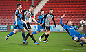 Pars' Shaun Byrne scores their second goal.
