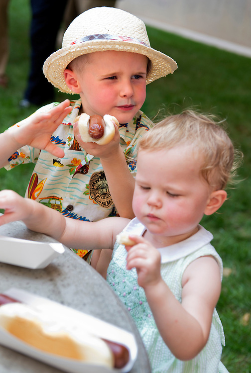 UNITED STATES - JULY 17: William Dierlam, 4, and his sister Emma, 23 months, eat hot dogs during the American Meat Institute's annual Hot Dog Lunch in the Rayburn courtyard. (Photo By Tom Williams/CQ Roll Call)