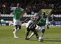 Nigel Hasselbank (centre) beats Pa Kujabi as Isaiah Osbourne looks on in the St Mirren v Hibernian Clydesdale Bank Scottish Premier League match played at St Mirren Park, Paisley on 29.4.12.