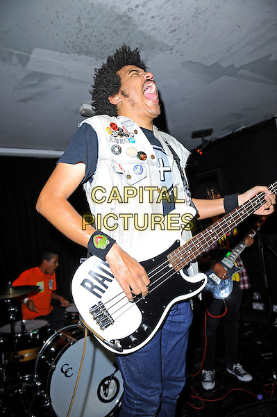 Isaiah Radke of Radkey <br /> performing in concert, The Blackeart, Camden, London, England. <br /> 17th October 2013<br /> on stage in concert live gig performance performing music half length white jean denim jacket sleeveless bass guitar profile mouth open<br /> CAP/MAR<br /> &copy; Martin Harris/Capital Pictures