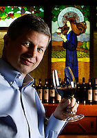 Ste. Michelle Wine Estates CEO Ted Baselerand is shown with a glass of 2004 Col Solare at one of the chateau tasting bars on the Woodinville, Wash. estate Thursday, Jan. 24, 2008. The company has 1,000 employees, with 800 based in Washington, and the company has $350 million in revenues and sell 5 million cases of wine. (Photo by Andy Rogers).