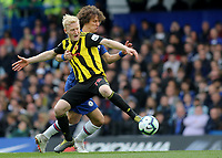 Will Hughes of Watford tries to retain possession of the ball in spite of a strong challenge from Chelsea's David Luiz during Chelsea vs Watford, Premier League Football at Stamford Bridge on 5th May 2019