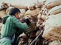 Iraq 2014, November 26, on the front near Kirkouk, a peshmerga of Hama Haji Mahmoud opening fire on daesh positions  Irak 2014  Le 26 novembre, sur le front pres de Kirkouk, un peshmerga de Hama Haji Mahmoud mitraillant les positions de daesh