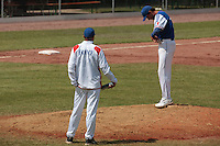 30 july 2010: Starting pitcher Samuel Meurant, nex to Team manager Sylvain Virey, is in pain after being hit in the arm by a ball during Sweden 3-2 win over France, in day 6 of the 2010 European Championship Seniors, at TV Cannstatt ballpark, in Stuttgart, Germany.