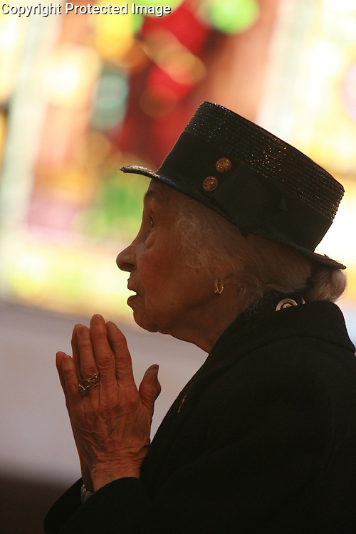 101 year-old Ernestine Llorens of East Harlem attending to service  April, 2nd  2006 at Our Lady Queen of Angels Church located at 226 East 113rd. St. in El Barrio, Manhattan..