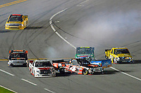 18-19 February, 2016, Daytona Beach, Florida USA<br /> Lap 40 crash as trucks race onto pit road just shy of the 20 minute caution.<br /> ©2016, F. Peirce Williams