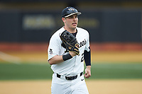 Wake Forest Demon Deacons right fielder Michael Ludowig (22) jogs off the field between innings of the game against the Sacred Heart Pioneers at David F. Couch Ballpark on February 15, 2019 in  Winston-Salem, North Carolina.  The Demon Deacons defeated the Pioneers 14-1. (Brian Westerholt/Four Seam Images)