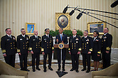 United States President Barack Obama meets with members of the Public Health Service Commissioned Corps (PHS CC) after signing a citation awarding the Presidential Unit Citation to PHS CC members who participated in the Ebola containment efforts in West Africa, in the Oval Office at The White House in Washington, D.C., U.S., on Thursday, Sept. 24, 2015. <br /> Credit: Rod Lamkey Jr. / Pool via CNP