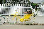 Yellow bicycle on Market Street, Mackinac Island. .