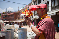 A Holy man praying in front of Buddha Nath temple in Kathmandu, Nepal