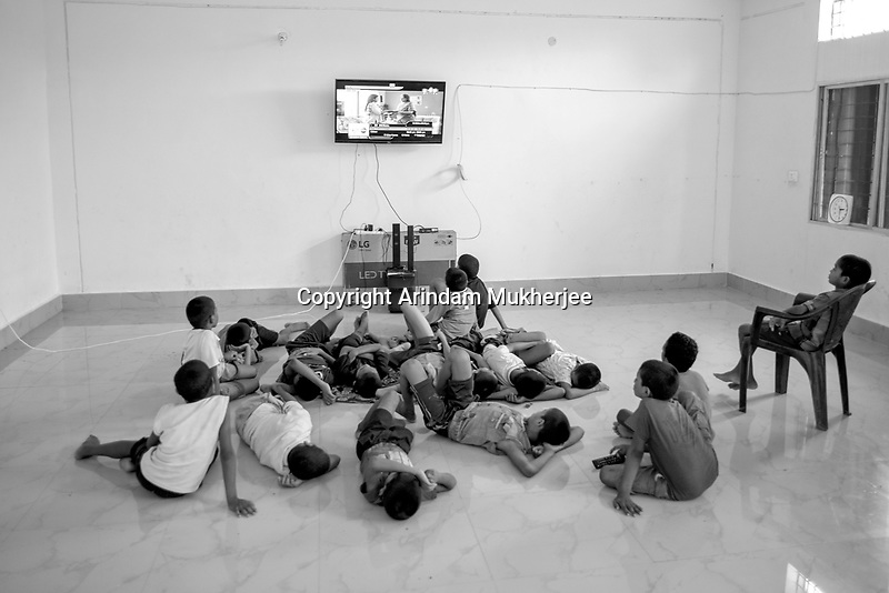 Students of Sukma Football Academy watching movie on television.Sukma, Chattisgarh, India. Arindam Mukherjee
