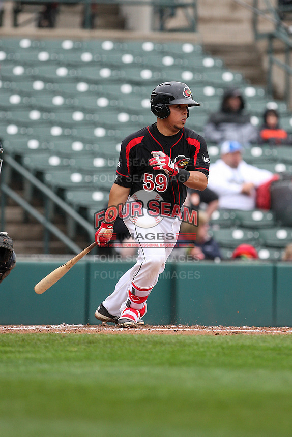 Catcher Juan Centeno (59) of the Rochester Red Wings bats against the Scranton Wilkes-Barre Railriders on May 1, 2016 at Frontier Field in Rochester, New York. Red Wings won 1-0.  (Christopher Cecere/Four Seam Images)