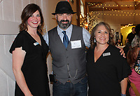 NWA Democrat-Gazette/CARIN SCHOPPMEYER Ann Meythaler (from left), Robert Depper and Crystal Vickmark, CASA of Northwest Arkansas executive director, gather the Celebration of Success on May 3 at the Barn at the Springs in Springdale.