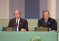 April 22,  2001, Montreal, Quebec, Canada<br /> <br /> Argentina President Fernando De La Rua (L) And US president George W, Bush listen to a journalist question at the closing press conference of the Summit of the Americas , April 22, 2001 in Quebec City, CANADA.<br /> <br /> De la Rua decided to impose martial law this week (dec 20, 2001) after riots and looting in maby cities