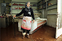 Pictured: A local woman cleans up her shop.<br /> Re: People have died, some still missing and severe damage caused by heavy rain and flash flooding in the area of Mandra, near Athens, Greece. Thursday 16 November 2017