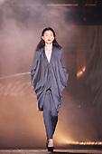 Model walking down catwalk wearing a grey outfit  by Kiki & Co.