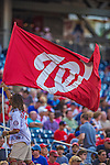 26 July 2013: A member of the Washington Nationals Nat Pack waves a flag prior to a game against the New York Mets at Nationals Park in Washington, DC. The Nationals bounced back from their loss in the first game of their day/night doubleheader, with a 2-1 nightcap win. Mandatory Credit: Ed Wolfstein Photo *** RAW (NEF) Image File Available ***