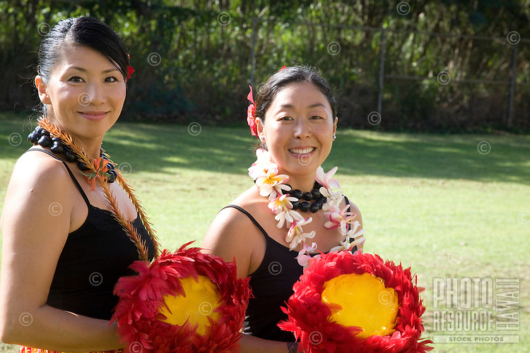 Local Asian ladies holding their uli uli before a hula performance