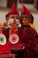 Buddhist monk preparing for a Losar ceremony in Sikkim, India