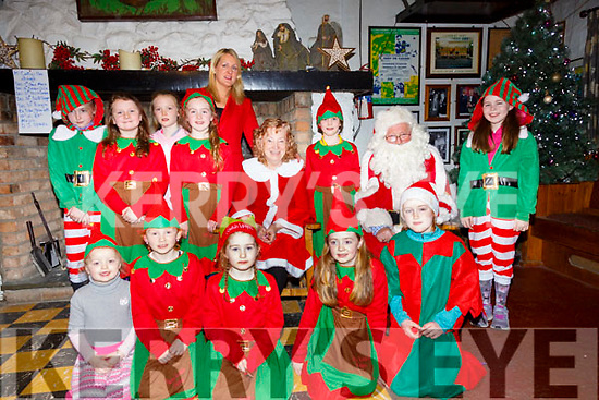 Santa & Mrs Claus with their elfs at McCarthys Bar, Finuge on Sunday evening last.